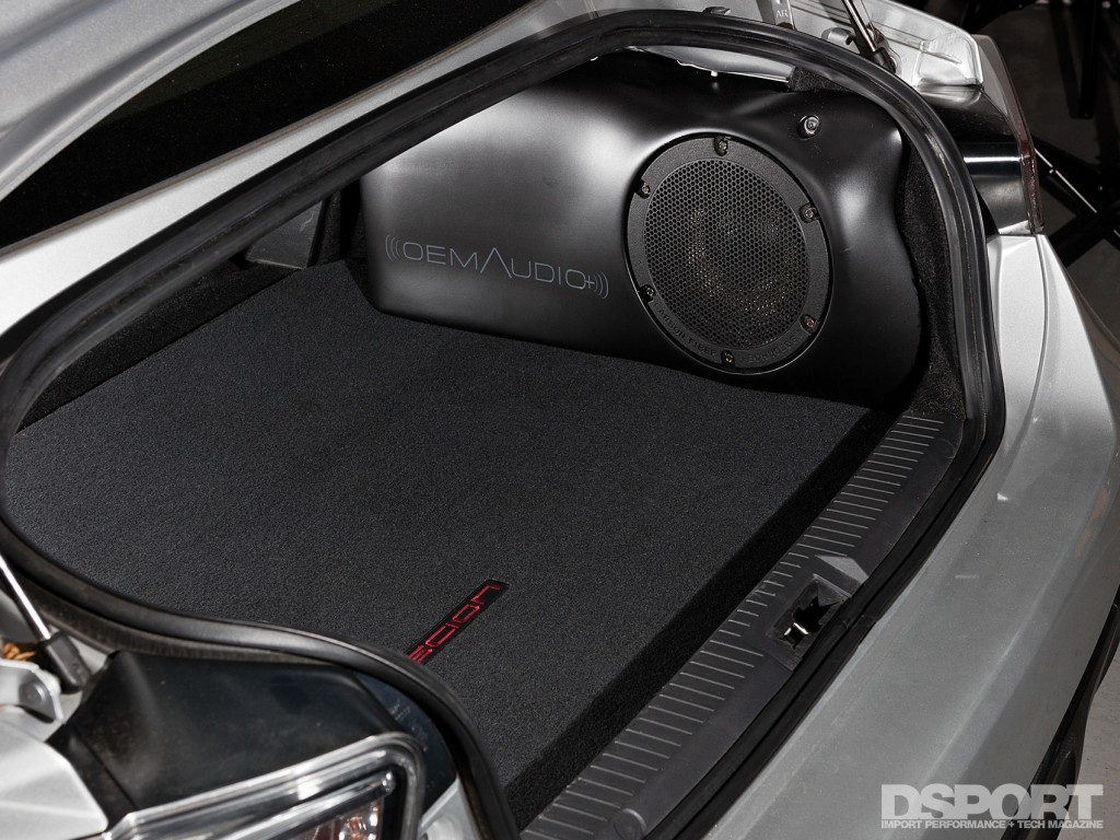 The trunk of the FR-S with OEM Audio+ sound system