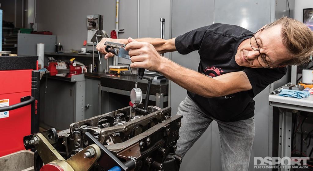 Magnus working on an engine block